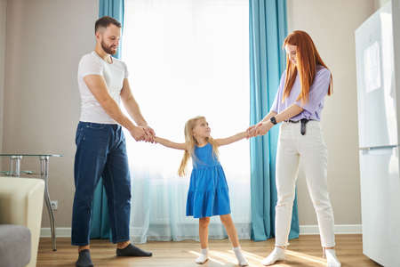 young mother and father share child girl, divided kid, going to ber divorced. they have amily conflict, scandal, quarrel between husband and wife