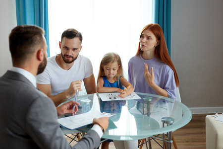 professional psychologist support young married family with daughter, they discuss problems, save family, talk about possible guardianship