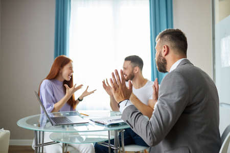 even professional psychologist is powerless to solve family problems, young caucasian couple is arguing in the presence of psychologist, listening them, ready to help