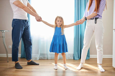 little daughter girl doesnt want parents to be divorced, sad girl listen to quarrels of parents, want happy family