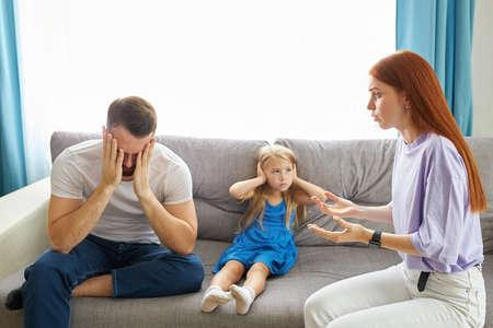 divorced caucasian parents arguing about child custody, divide property and child. parental fmaily quarrels concept