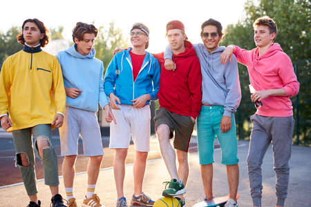 diverse young city boys are ready to play basketball together, sport club members have fun outdoors, in casual wear. portrait Imagens