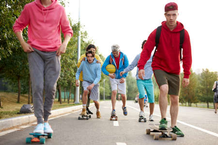 happy teenagers skateboarder boys have fun outdoors, caucasian youth generation freetime spending concept image