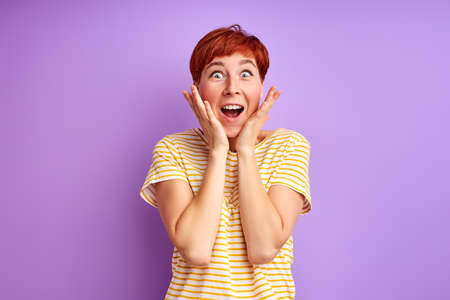 excited woman is surprised by something, stand shouting, expressing happiness, human emotions concept