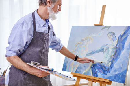 artist painter man painting picture on canvas. happy retirement lifestyle concept Archivio Fotografico