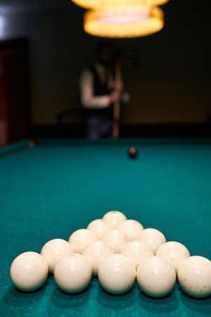 white billiard balls on a blue billiard table. gambling game of billiards. close-up