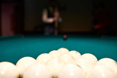 sports game of billiards on a blue cloth. white billiard balls close-up. cue ball on a pool table