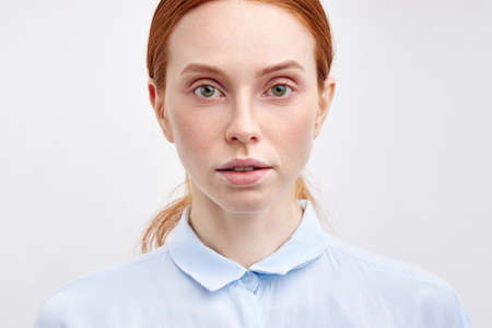 Portrait Of Confident Serioys Woman With Red Haire Looking At Camera