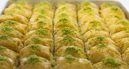 filo: Slim classic pistachio baklava filo pastry prepared from Stock Photo