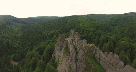 Aerial photo shot Rocks above Forest and Mountains