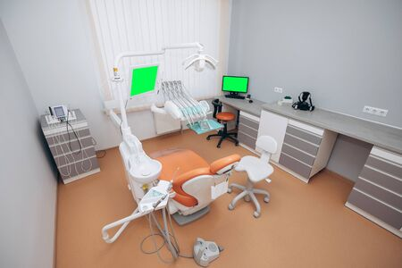 Modern dentistry office interior with chair and tools Stock Photo