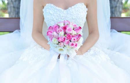 head dress: Bride holding flower bouquet. Stock Image.