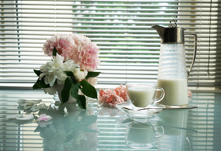 still life, splendid bouquet peony and Antique jug and cup of milk