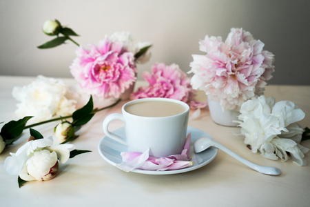 fresh cappuccino in the white cup, still life with peonies Stock Photo
