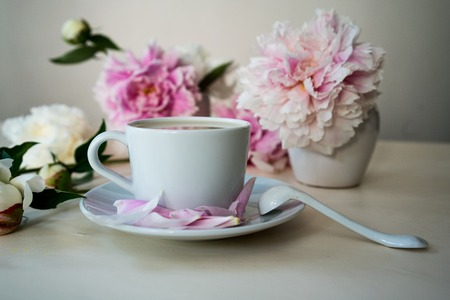 Traditional English tea with milk, still life with peonies