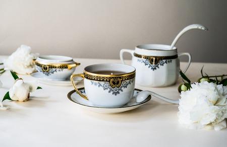 tea service: antique tea service and fresh peonies, still life Stock Photo