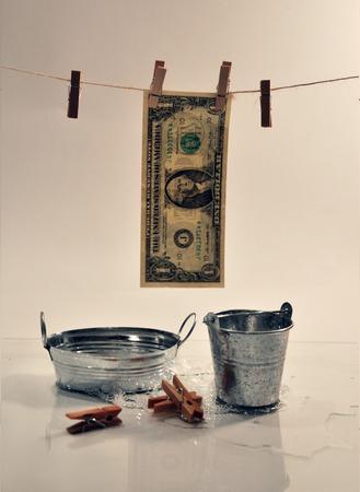 bucket of money: one US dollar. normal washing Association Stock Photo