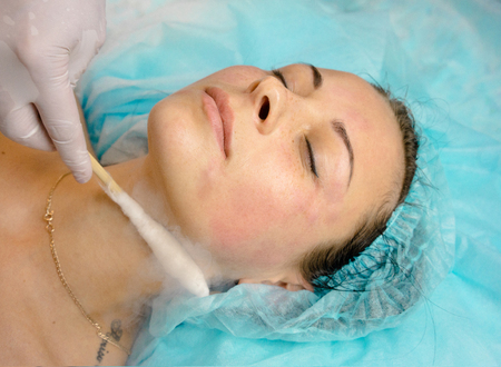 deep cleansing facial with nitrogen in the clinic. face of a beautiful young woman close-up