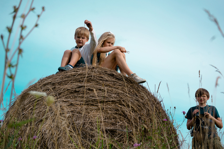 children play in the haystack, and making a movie