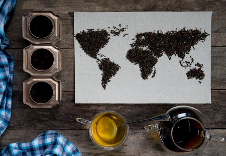 eurasia: map of the world, lined with tea leaves on old paper. Eurasia, America, Australia, Africa.