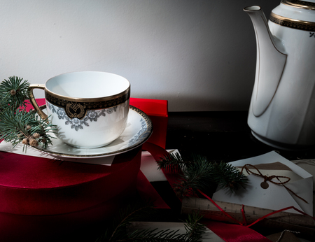 12 month old: ancient antique cup on the Christmas table with presents letters, envelopes and invitations