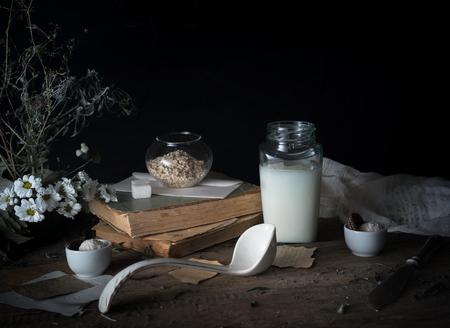 rustic breakfast. still life, vintage. the book chrysanthemums, the milk bank. black background