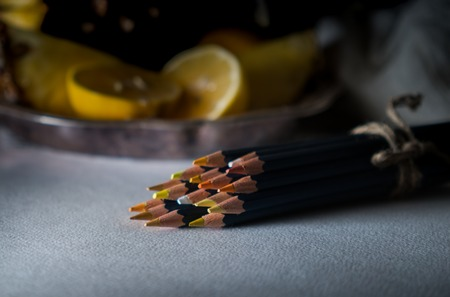 set of colored pencils on a table   background  tropical fruit