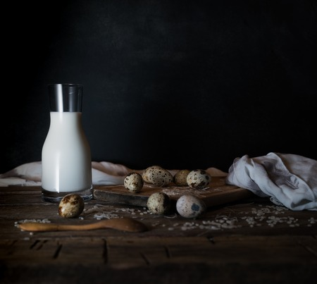 Fresh organic eggs, milk and butter, still life in rustic style, vintage wooden background. Stockfoto