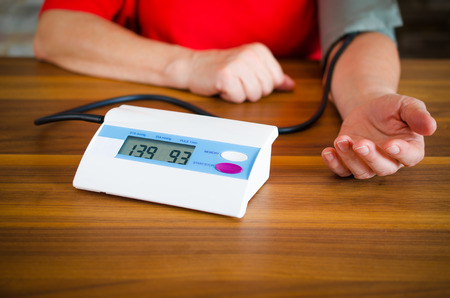Woman measuring her blood pressure Reklamní fotografie