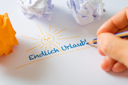 smile close up: Hand writing holiday-message in german on white paper