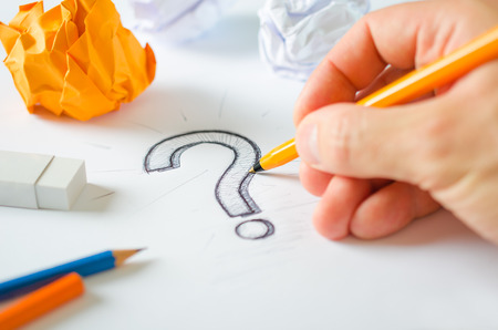 Designer hand drawing question mark