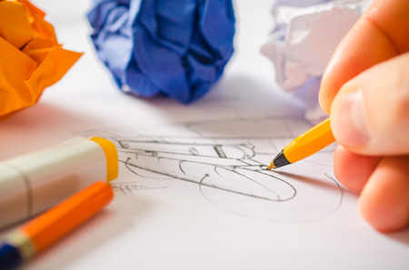 A designer drawing sketches