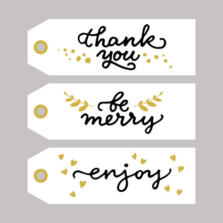 to thank: Gold and black gift tags with handwritten messages Thank you, Be merry, Enjoy