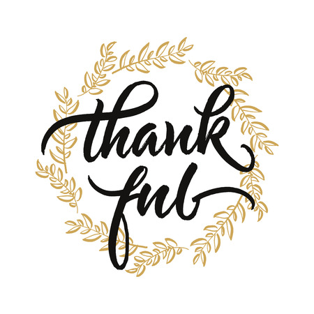 Thankful handwritten lettering. Thanksgiving greeting card with autumn leaves wreath.