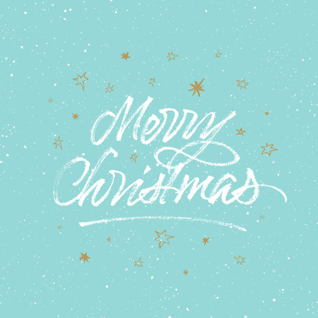 Merry Christmas brush calligraphy. Greeting card with golden stars on light blue splattered background.