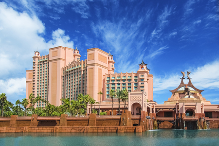 Amazing fortress like building surrounded by water and palm trees in Nassau, Bahamas on a sunny summer day