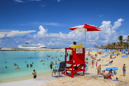 Great Stirrup Cay, Bahamas - October 28, 2011; Tourists enjoying sunny weather in Great Strirrup Cay island in Bahamas.