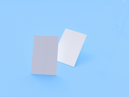 render 3d images of business cards dynamically scattered on a blue background. Stock Photo