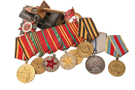 heroism: Orders, Medals and mock gun the Great Patriotic War on a white background