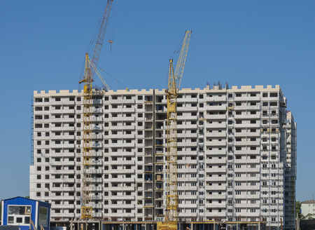 cement solution: White high-rise building at the stage of completion of the close-up Stock Photo