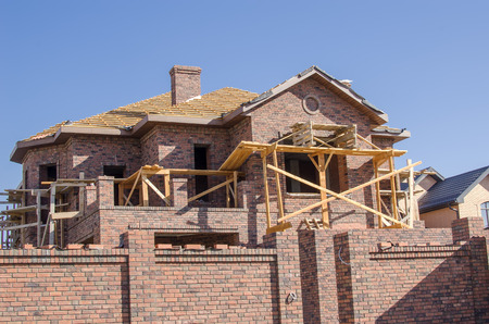 cement solution: Unfinished Country house of brown brick.