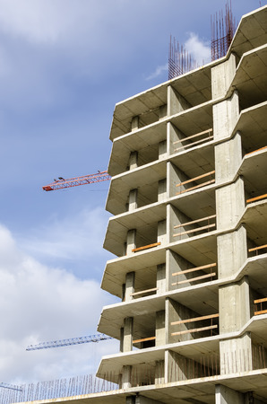 lowering: Detail of house under construction close-up against the sky