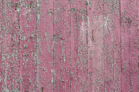 Pink old rough boards located vertically.