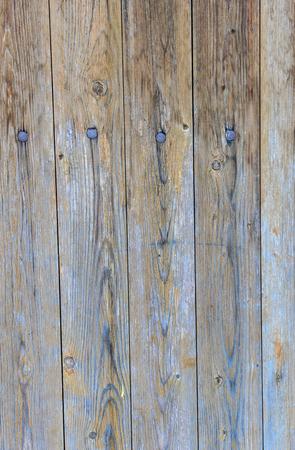 Wooden background the nekrashennykh of figured boards with nails.