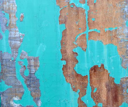 Texture of rusty metal with old green paint close up.