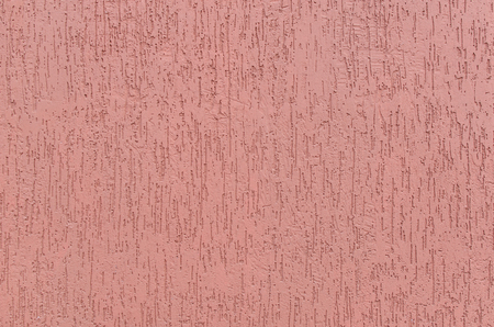 Uniform pink background of plaster with vertical furrows. 版權商用圖片