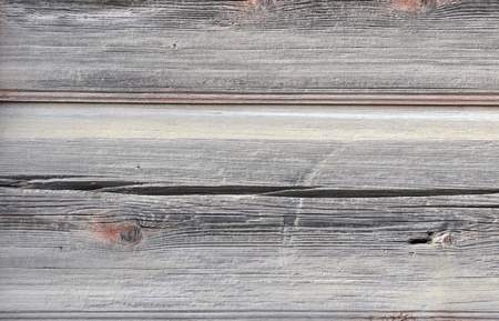 Plate from the old brownish-gray horizontal cracked boards.