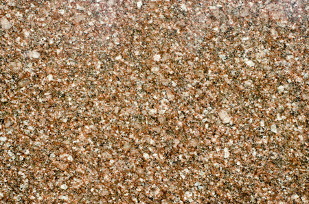 Background of ravnomernokristallichesky structure of brown granite close up.