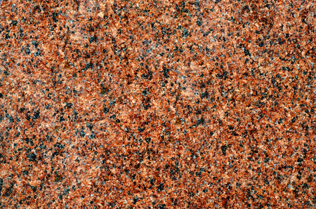 Background of brown-black granite with granular structure 스톡 콘텐츠