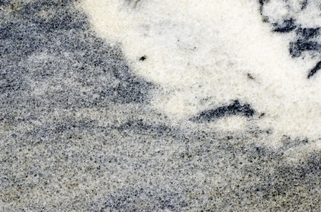Marble background with granular and striate structure and white spots. 스톡 콘텐츠